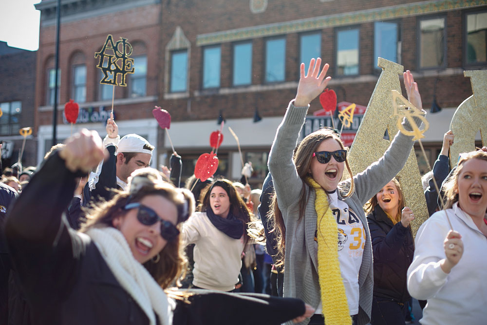 Members of an MU sorority walk during the parade on Saturday, October 26, 2013.